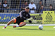 AFC Wimbledon goalkeeper Tom King (1) warming up during the EFL Sky Bet League 1 match between AFC Wimbledon and Scunthorpe United at the Cherry Red Records Stadium, Kingston, England on 15 September 2018.