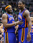 New York Knicks guard Bill Walker (5) consoles Knicks forward Amar'e Stoudemire (1) as he reacts to getting fouled by the Utah Jazz during the first half of an NBA basketball game in Salt Lake City, Wednesday Jan. 12, 2011. (AP Photo/Colin E Braley)