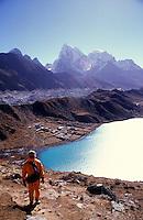 A young woman climbs up Gokyo Peak in the Sagarnatha National Park, Sollu Khumbu region of Nepal.