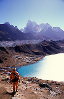 A young woman climbs up Gokyo Peak in the Sagarnatha National Park, Sollu Khumbu region of Nepal.