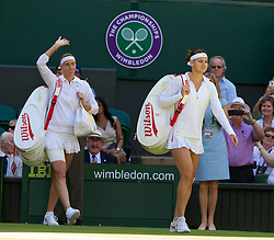 LONDON, ENGLAND - Thursday, July 3, 2014: Lucie Safarova (CZE) and Petra Kvitova (CZE) walk onto Centre Court before the all-Czech Ladies' Singles Semi-Final match on day ten of the Wimbledon Lawn Tennis Championships at the All England Lawn Tennis and Croquet Club. (Pic by David Rawcliffe/Propaganda)