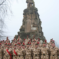 The Black Watch Homecoming Parade, Aberfeldy....10.12.09<br /> Soldiers of the Black Watch pose for a photograph by the Black Watch memorial in Aberfeldy after parading through the town on their return from Afghanistan......Aberfeldy is where the 'Companies' of men were mustered in 1667, the dark tartans that the men wore to distinguish them from the 'Red Soldiers' led them to becoming known as 'Freiceadan Dubh' or 'The Black Watch'<br /> Picture by Graeme Hart.<br /> Copyright Perthshire Picture Agency<br /> Tel: 01738 623350  Mobile: 07990 594431
