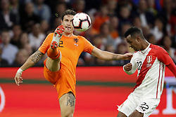 (L-R) Daryl Janmaat of Holland, Nilson Loyola of Peru during the International friendly match match between The Netherlands and Peru at the Johan Cruijff Arena on September 06, 2018 in Amsterdam, The Netherlands