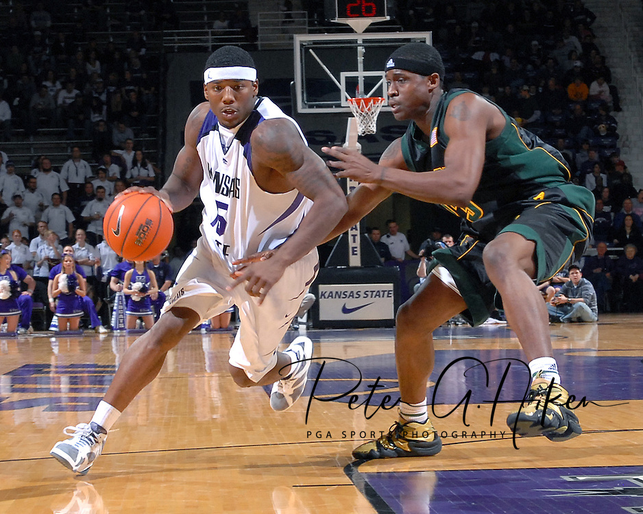 Kansas State forward David Hoskins (L) drives around Baylor forward Kevin Rogers (R), during the second half at Bramlage Coliseum in Manhattan, Kansas, January 17, 2007. K-State beat Baylor 69-60.