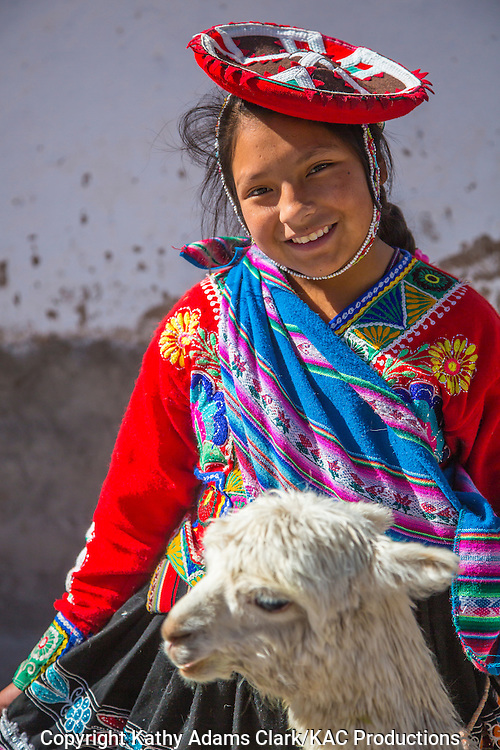Lady in traditional dress in Cusco, Peru, with llama. Hat denotes village or region.