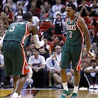 22 January 2012: Milwaukee Bucks point guard Brandon Jennings (3) celebrates with Milwaukee Bucks shooting guard Stephen Jackson (5) during the Milwaukee Bucks 91-82 victory over the Miami Heat at the AmericanAirlines Arena, Miami, Florida, USA.