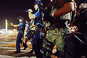 Police and protesters clash in Ferguson following the murder of Mike Brown.