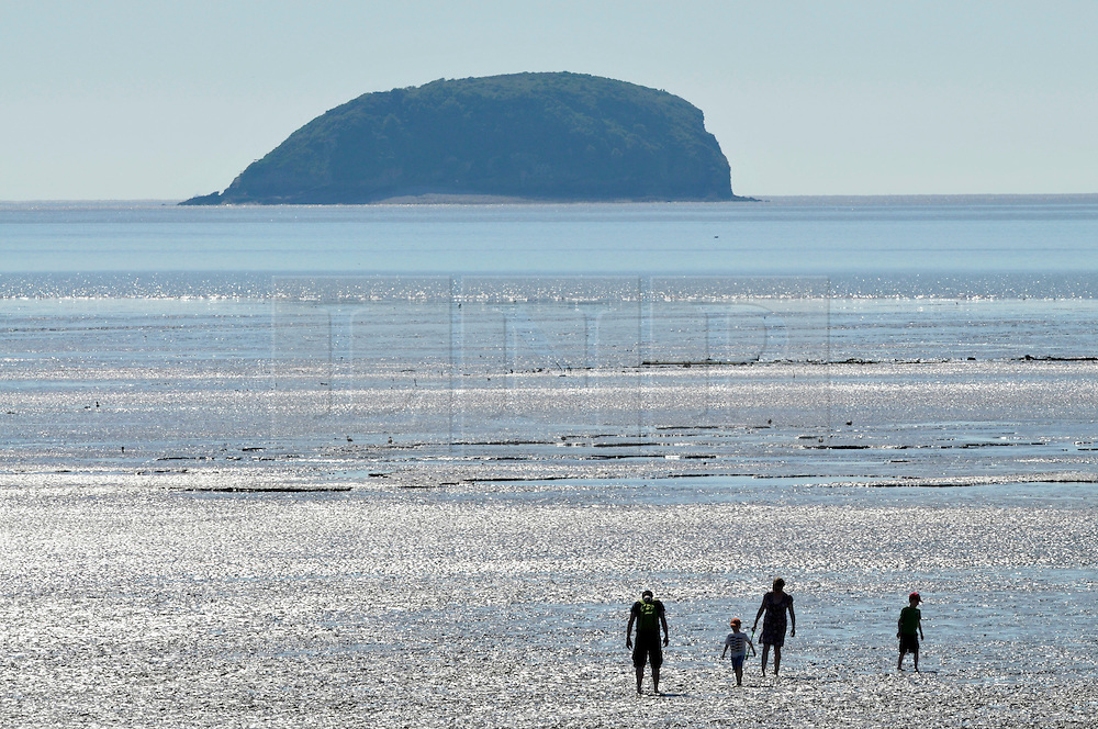 © Licensed to London News Pictures. 23/07/2012. The beach and Grand Pier at Weston-super-Mare with the island of Steep Holm in the background, Somerset, UK.  23 July 2012..Photo credit : Simon Chapman/LNP