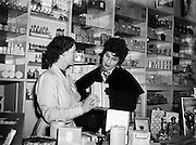 "Mr Eamon Andrews and Alma Cogan at Woulfes Pharmacy, Grafton St.01/12/1954..Alma Cogan (19/05/1932 - 26/10/1966) was an English singer of traditional pop music in the 1950s and early 1960s. Dubbed ""The Girl With the Laugh/Giggle/Chuckle In Her Voice"", she was the highest paid British female entertainer of her era. Throughout the mid-1950s, she was the most consistently successful female singer in the UK."