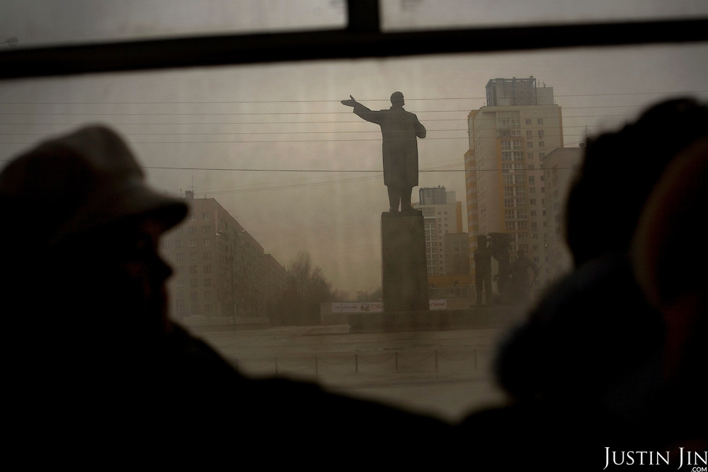 Bus passengers ride pass a statue of Lenin in Nizhny Novgorod, Russia's third largest city. Dubbed Russia's third capital, the city of 1.3 million was closed to foreigners for many decades because of its connection with the military.