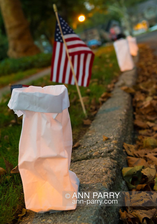 Sept. 11, 2012 - Merrick, New York, U.S. - At dusk, 500 Luminary Bags are distributed among the 215 Wenshaw Park homes on the 11th Anniversary of 9/11, by Wenshaw Park Civic Association, Long Island, with over $500 already raised for Twin Towers Orphan Fund. The tea candle in each bag will self-extinguish overnight, and volunteers will collect the bags on 9/12.