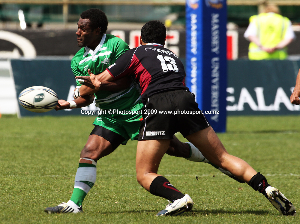 Manawatu's Tomasi Cama passes in the tackle of George Pisi.<br /> Air NZ Cup rugby - Manawatu Turbos v North Harbour at FMG Stadium, Palmerston North, New Zealand. Saturday, 24 October 2009. Photo: Dave Lintott/PHOTOSPORT