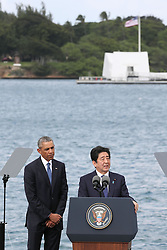 "US-Präsident Barack Obama und Japans Premier Shinzo Abe beim Gedenken an die Opfer des japanischen Angriffs auf Pearl Harbor vor 75 Jahren / 271216<br /> <br /> <br /> <br /> ***Japanese Prime Minister Shinzo Abe (R) gives a speech, along with U.S. President Barack Obama, at Pearl Harbor in Hawaii on Dec. 27, 2016, offering his ""sincere and everlasting condolences"" for those who died in the Japanese attack there in 1941.<br /> ***"
