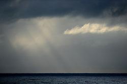 NORTHERN PACIFIC ESPERANZA 8NOV07 - Rays of sunlight penetrate between the clouds before sunset seen from aboard the MY Esperanza in the northern Pacific...jre/Photo by Jiri Rezac..© Jiri Rezac 2007..Contact: +44 (0) 7050 110 417.Mobile:  +44 (0) 7801 337 683.Office:  +44 (0) 20 8968 9635..Email:   jiri@jirirezac.com.Web:    www.jirirezac.com..© All images Jiri Rezac 2007 - All rights reserved.