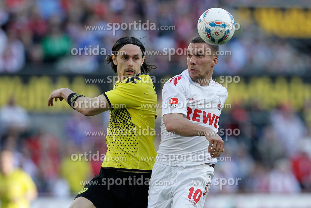 25.03.2012, Rhein Energie Stadion, Koeln, GER, 1. FBL, 1.FC Koeln vs Borussia Dortmund, 27. Spieltag, im Bild duell Lukas PODOLSKI (1.FC Koeln #10) - Neven SUBOTIC (BVB Borussia Dortmund #4) // during the German Bundesliga Match, 27th Round between 1.FC Koeln and Borussia Dortmund at the Rhein Energie Stadion, Koeln, Germany on 2012/03/25. EXPA Pictures © 2012, PhotoCredit: EXPA/ Eibner/ Gerry Schmit..***** ATTENTION - OUT OF GER *****