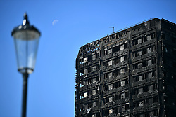 © Licensed to London News Pictures. 17/06/2017. London, UK. The scene of a fire at the Grenfell tower block in west London earlier this week. The blaze engulfed the 27-storey building killing 12 - with 34 people still in hospital, 18 of whom are in critical condition. The fire brigade say that they don't expect to find anyone else alive. Photo credit: Ben Cawthra/LNP