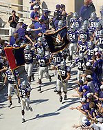 The Kansas State Wildcats come storming out the the locker room lead by Wildcat Byron Garvin (6) before their game with Oklahoma State at Bill Snyder Family Stadium in Manhattan, Kansas, October 7, 2006.  The Wildcats beat the Cowboys 31-27.<br />