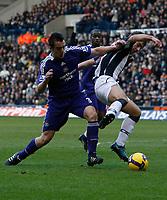 Photo: Steve Bond/Richard Lane Photography. West Bromwich Albion v Newcastle United. Barclays Premiership. 07/02/2009. James Morrison (R) is pushed off the ball by Jose Enrique (L)