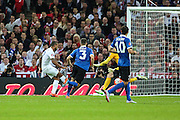 England's Theo Walcott scores for his team just before the halftime interval during the UEFA European 2016 Qualifier match between England and Estonia at Wembley Stadium, London, England on 9 October 2015. Photo by Shane Healey.