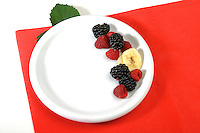 Berries on white plate - studio shot