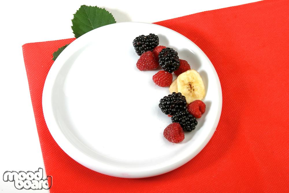 Berries on white plate - studio shot
