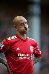 LIVERPOOL, ENGLAND - Sunday, October 3, 2010: Liverpool's Raul Meireles looks dejected as his side crash to an embarrassing 2-1 defeat to Blackpool during the Premiership match at Anfield. (Photo by David Rawcliffe/Propaganda)