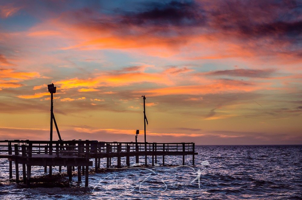 The sun sets at Cedar Point Fishing Pier, Dec. 3, 2013. (Photo by Carmen K. Sisson/Cloudybright)