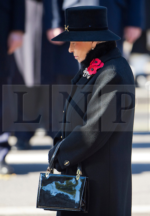 © London News Pictures. 10/11/2013. London, UK. HRH Queen Elizabeth II  during the Remembrance Day Ceremony at the Cenotaph war memorial in London, United Kingdom, on November 10, 2013 . Royalty and Politicians joined the rest of the county in honouring the war dead by gathering at the iconic memorial to lay wreaths and observe two minutes silence. Photo Credit: Ben Cawthra/LNP