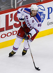 March 19, 2008; Newark, NJ, USA;  New York Rangers right wing Jaromir Jagr (68) skates with the puck during the third period at the Prudential Center. The Rangers beat the Devils 2-1 in an overtime shootout.