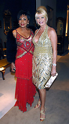 Left to right, DAME SHIRLEY BASSEY and IVANA TRUMP at the Grosvenor House Art & Antiques Fair Gala evening in aid of the UK