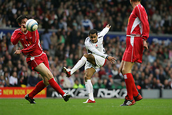 LIVERPOOL, ENGLAND - SUNDAY MARCH 27th 2005: Liverpool Legends' Gary Ablett tries to block Celebrity XI's Harvey during the Tsunami Soccer Aid match at Anfield. (Pic by David Rawcliffe/Propaganda)