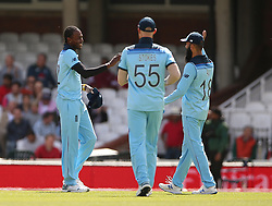 England's Jofra Archer (left) celebrates with Moeen Ali (right) after taking the wicket of Afghanistan's Rahmat Shah during the ICC Cricket World Cup Warm up match at The Oval, London.