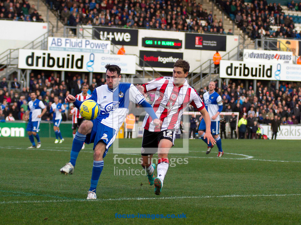 Picture by Sophie Elbourn/Focus Images Ltd +447595 944177.03/11/2012.Michael Smith of Bristol Rovers and Shaun Miller of Sheffield Utd during the FA Cup match at the Memorial Stadium, Bristol.