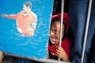 Simpatizantes del gobierno del presidente venezolano, Nicolás Maduro manifiestan en las afueras del Cuartel de La Montaña, sector 23 de Enero, para recordar el primer aniversario de la muerte del presidente Hugo Chávez Frías. Caracas, 05 de marzo de 2014. (Foto/Ivan Gonzalez)