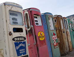 abandoned gas pumps lined up