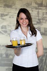 Waitress in a VIP Lounge  in Arena Stozice, Ljubljana, Slovenia. (Photo by Vid Ponikvar / Sportida.com)