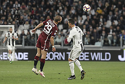May 3, 2019 - Turin, Piedmont, Italy - Lorenzo De Silvestri (Torino FC) and Cristiano Ronaldo (Juventus FC) competes for the ball during the Serie A football match between Juventus FC and Torino FC at Allianz Stadium on May 03, 2019 in Turin, Italy..Final results: 1-1. (Credit Image: © Massimiliano Ferraro/NurPhoto via ZUMA Press)