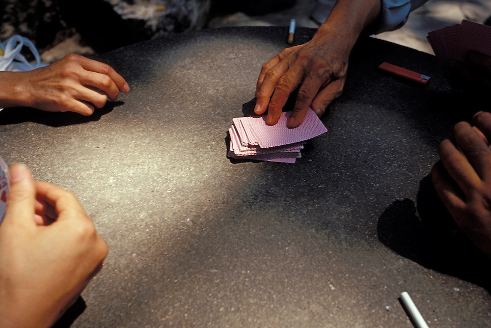 SHANGHAI, CHINA. Men playing cards at a park in Huangpu, in the northern side of Shanghai, China.