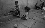 A young boy and his sister playing in an alley. Bangalore, India.  (1975)