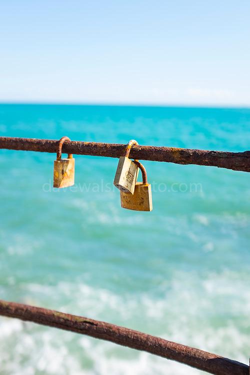 Love locks on rusty raililngs, Sant Pol de Mar, Catalonia