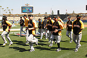 LOS ANGELES, CA - APRIL 10:  The Pittsburgh Pirates jog warm up before batting practice at the game against the Los Angeles Dodgers on Tuesday, April 10, 2012 at Dodger Stadium in Los Angeles, California. The Dodgers won the game 2-1. (Photo by Paul Spinelli/MLB Photos via Getty Images)