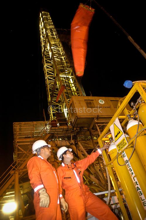 Workers inspecting an Pemex oil rig in the Mexico.