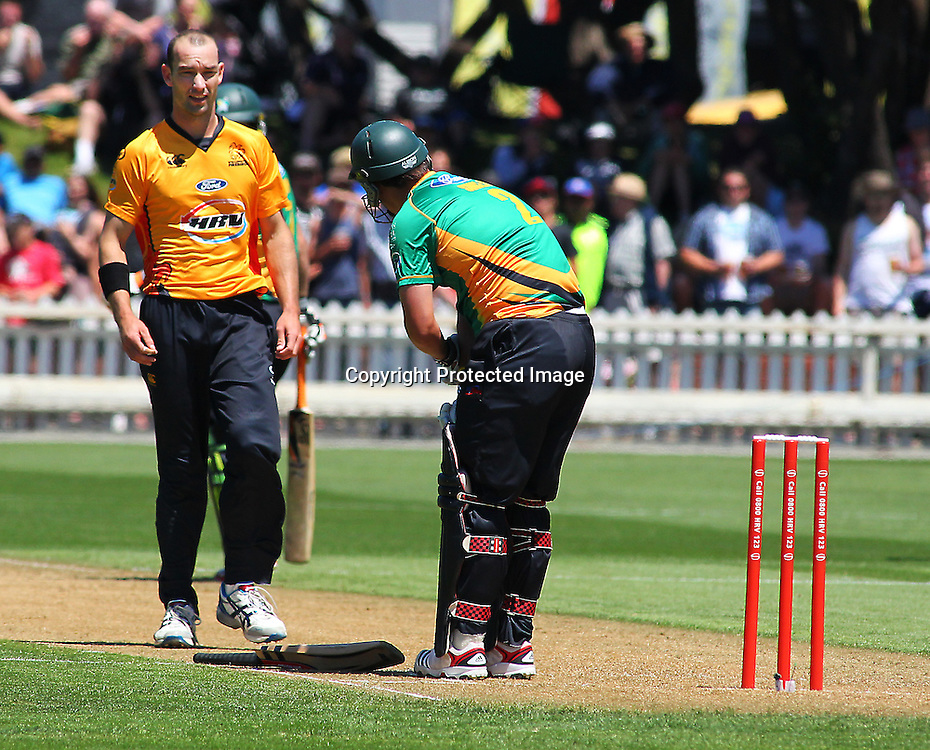 Andy McKay hits Mathew Sinclair with a beamer during their Twenty20 Cricket match - HRV Cup, Wellington Firebirds v Central Stags, 27 December 2011, Hawkins Basin Reserve, Wellington. . PHOTO: Grant Down / photosport.co.nz