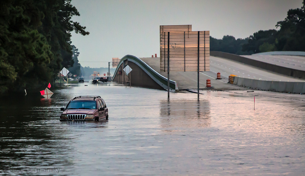 Aug. 31, 2017, Vidor, Texas, a car stuck on flood waters at the exit ramp off Interstate 10.