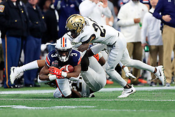 Auburn Tigers wide receiver Nate Craig-Myers (3) runs past UCF Knights defensive back Richie Grant (27) after a catch during the 2018 Chick-fil-A Peach Bowl NCAA football game on Monday, January 1, 2018 in Atlanta. (Paul Abell / Abell Images for the Chick-fil-A Peach Bowl)