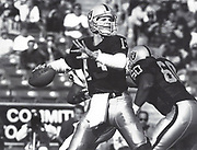 Los Angeles Raiders quarterback Jay Schroeder (13) throws the ball against the Cincinnati Bengals during an NFL football game, Sunday, Dec. 16, 1990, in Los Angeles. The Raiders defeated the Bengals 24-7.