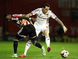 Middlesbrough's Lee Tomlin clashes with Brentford's Moses Odubajo - Photo mandatory by-line: Robbie Stephenson/JMP - Mobile: 07966 386802 - 08/05/2015 - SPORT - Football - Brentford - Griffin Park - Brentford v Middlesbrough - Sky Bet Championship
