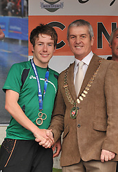 Cllr Ollie Gannon Cathaoirleach of Westport Town Council congratulates Con Doherty his World Junior Triathlon Bronze medal ...Pic Conor McKeown