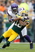 GREEN BAY, WI - DECEMBER 2:  Jasper Brinkley #54 of the Minnesota Vikings tackles Randall Cobb #18 of the Green Bay Packers at Lambeau Field on December 2, 2012 in Green Bay, Wisconsin.  The Packers defeated the Vikings 23-14.  (Photo by Wesley Hitt/Getty Images) *** Local Caption *** Jasper Brinkley; Randall Cobb Sports photography by Wesley Hitt photography with images from the NFL, NCAA and Arkansas Razorbacks.  Hitt photography in based in Fayetteville, Arkansas where he shoots Commercial Photography, Editorial Photography, Advertising Photography, Stock Photography and People Photography