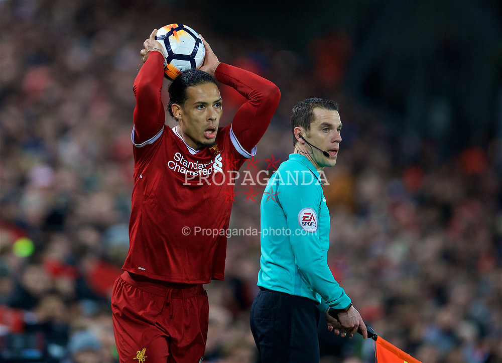 LIVERPOOL, ENGLAND - Sunday, January 14, 2018: Liverpool's Virgil van Dijk takes a throw-in during the FA Premier League match between Liverpool and Manchester City at Anfield. (Pic by David Rawcliffe/Propaganda)